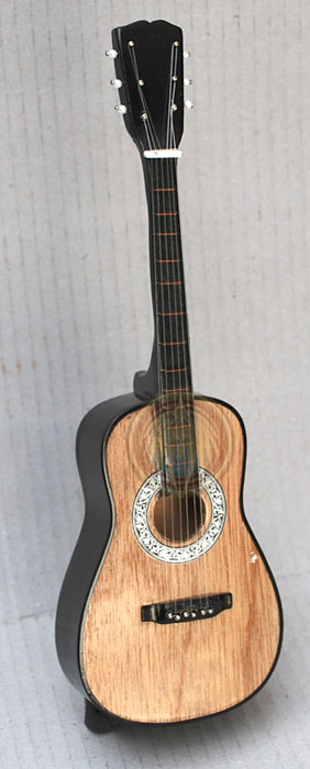 Natural wood color acoustic guitar